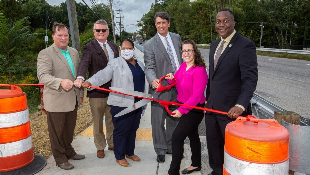 Strengthening Safety and Community: Paddock Pointe Cuts Ribbon on Route 1 Sidewalk Improvement Project
